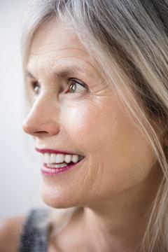 Smiling Caucasian woman looking away