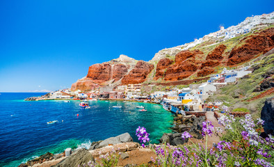 The old harbor of Ammoudi under the famous village of Ia at Santorini, Greece. Wall mural