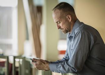 Caucasian businessman texting on cell phone