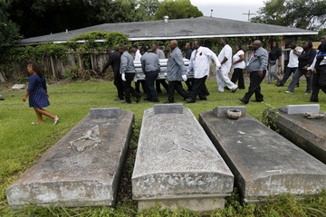 Family members and friends attend the burial of Alton Sterling at the Mount Pilgrim Benevolent Society Cemetery in Baton Rouge