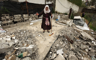 A woman stands in the debris of her house which was demolished by municipal workers at Diar Elaffia neighbourhood in eastern Algiers