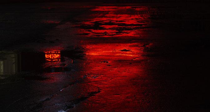 wet road asphalt reflections, red light