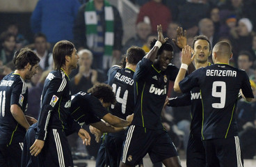 Real Madrid players celebrate a goal against Racing Santander during their Spanish first division soccer match in Santander