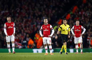 Arsenal's Mertesacker, Wilshere and Koscielny react after a goal of Bayern Munich's Kroos during their Champions League round of 16 first leg soccer match in London