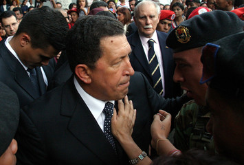 Venezuelan President Hugo Chavez greet supporters outside the Attorney General's office.