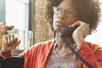 Black businesswoman talking on telephone
