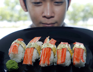 Filipino chef Araneta Jr. shows sushi garnished with .20-carat African diamonds and wrapped with 24-karat gold leaves in a restaurant in Manila
