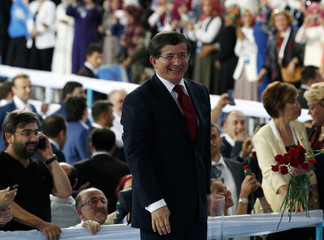 Turkey's Foreign Minister Ahmet Davutoglu greets his supporters during the Extraordinary Congress of the ruling AK Party in Ankara
