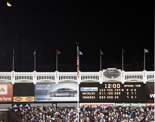 The moon passes over during the final regular season MLB American League baseball game at Yankee Stadium in New York