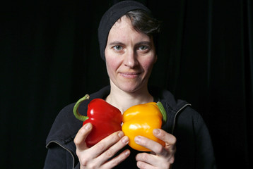 Austrian musician Susanna Gartmayer poses for a picture with a musical instrument made from vegetables in Haguenau, eastern France