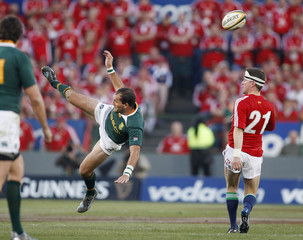 South Africa's Fourie du Preez contests the ball with British and Irish Lions player Ronan O'Gara during the second rugby union test match  in Pretoria