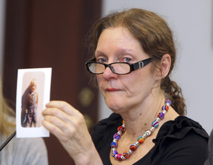 Mother of WikiLeaks founder Assange holds a picture of her son during a media conference in Quito