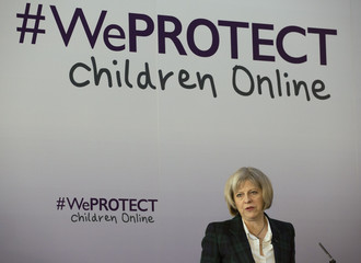 Britain's Home Secretary Theresa May speaks at the #WeProtect Children Online summit, at Lancaster House in London