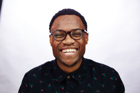 attractive young black male studio laughing and smiling