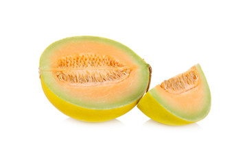 portion cut fresh yellow melon with stem on white background
