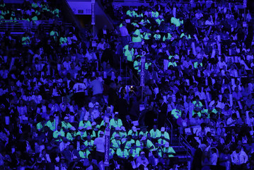 Bernie Sanders supporters wear yellow flourescent shirts to stand out when lights are dimmed at the Democratic National Convention in Philadelphia, Pennsylvania