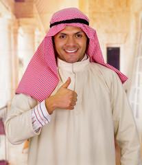smiling cute young arabian man posing happy