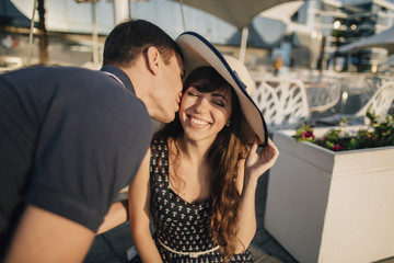 Caucasian man kissing woman on cheek