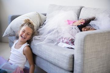 Laughing girls playing on sofa