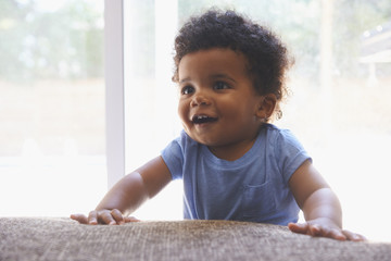 Portrait of smiling Black baby boy