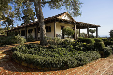 Exterior of Spanish Style Home and Landscape