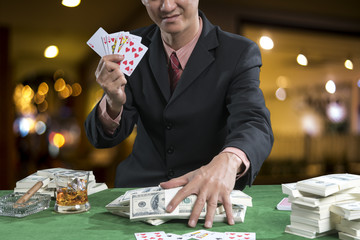 The player gather the bets when the points over rival on green table