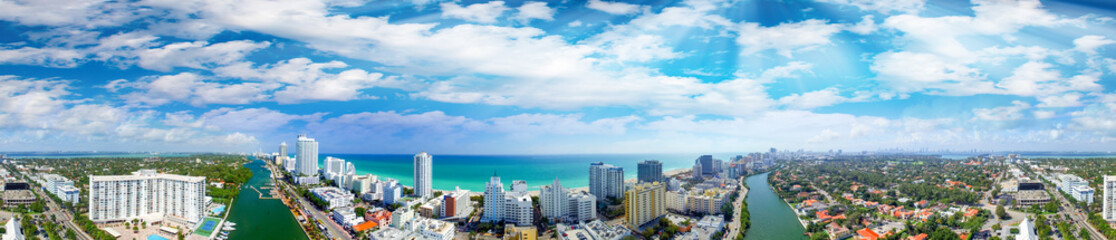 Miami Beach buildings and coastline - Panoramic aerial view at sunset