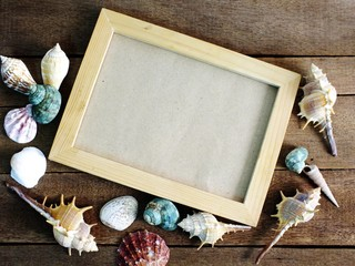 frame for a photo in a marine style on wooden background summer concept