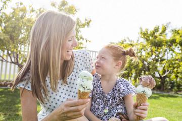Caucasian mother and daughter eating ice cream cones
