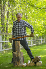 Caucasian man chopping wood