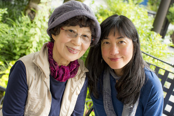 Portrait of smiling older Japanese mother and daughter