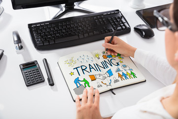 Woman Drawing Training Chart On Notebook