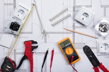 Electrical Instrument With Tools On A Blueprint Wall mural