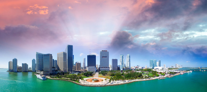 Panoramic aerial view of Miami Downtown at sunset. Buildings and ocean