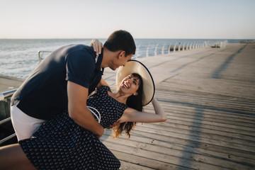 Caucasian man dipping woman at waterfront
