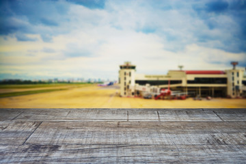 Perspective wood and blurred airport with bokeh background, product display montage