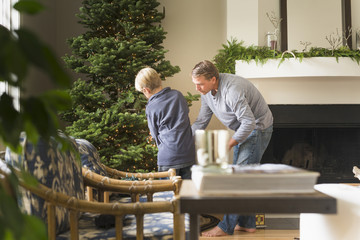 Caucasian father and son decorating Christmas tree