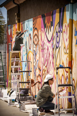 People painting on wall