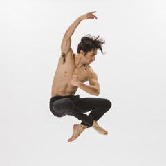 Mixed Race man ballet dancing