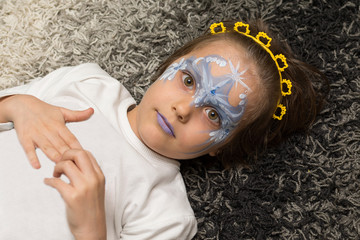Portrait of little girl with face painting