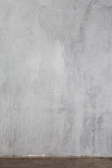 A textured gray wall in a minimalist style.