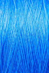 reel blue silk thread. textile concept. abstract background