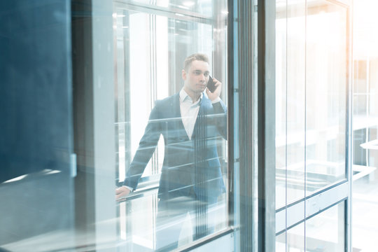 Portrait of businessman in elevator