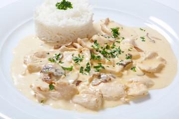 stewed chicken with white rice and mashroom sauce