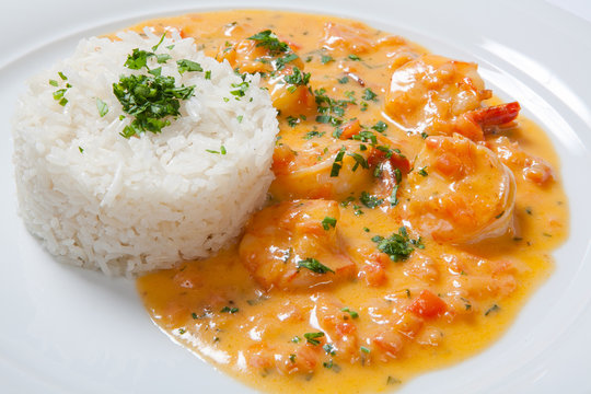 souse shrimp with greens and rice on a white background