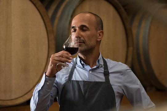 Winemaker tasting wine