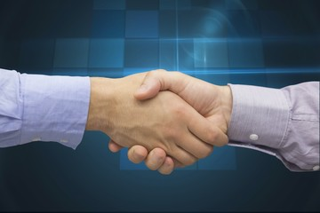 Cropped image of businessman shaking hands