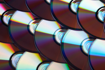 Compact discs background. Several cd dvd blu-ray discs. Optical recordable or rewritable digital data storage.