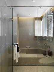 Large bathtub behind glass wall and door
