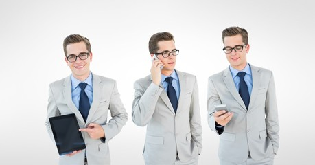 Multiple image of businessman with smart phone and tablet PC